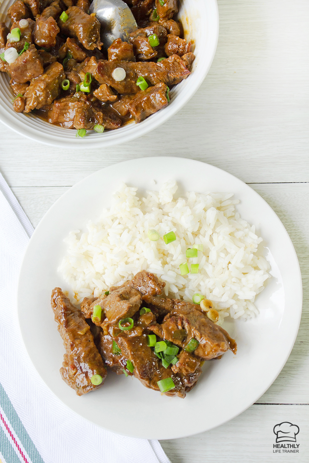 chilli beef in a plate with rice