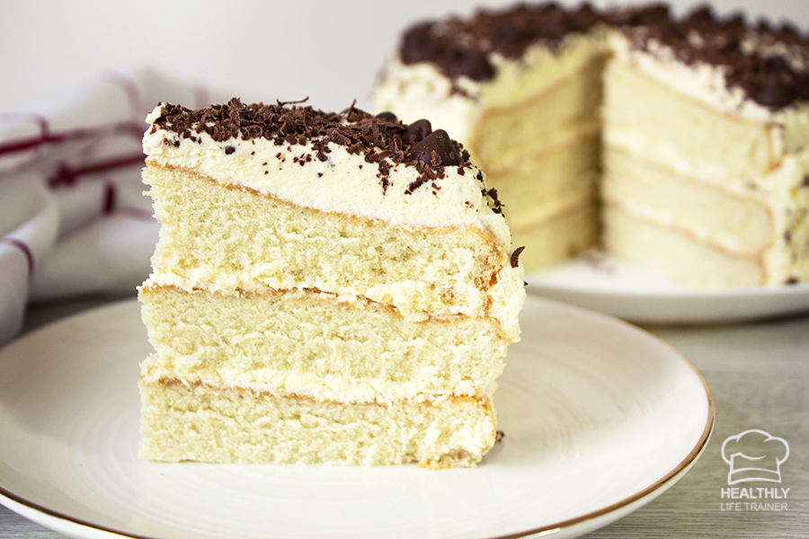 Easy Vanilla Cake – Three layers of fluffy sponge cake made from scratch.