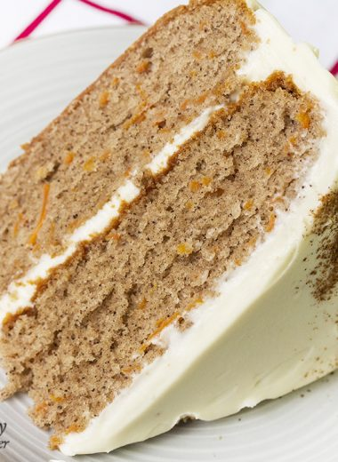 Carrot Cake With Cream Cheese Frosting – is a two-layered perfectly spiced, fluffy and moist cake with a hint of cinnamon and a dense cream cheese frosting.