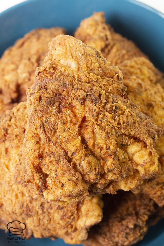 close shot to a fried chicken thigh