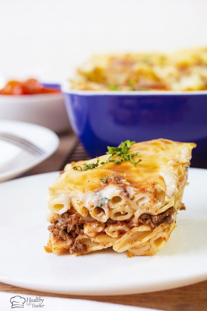 Macaroni Bechamel is layered with a well-seasoned beef mixture and topped with creamy bechamel sauce