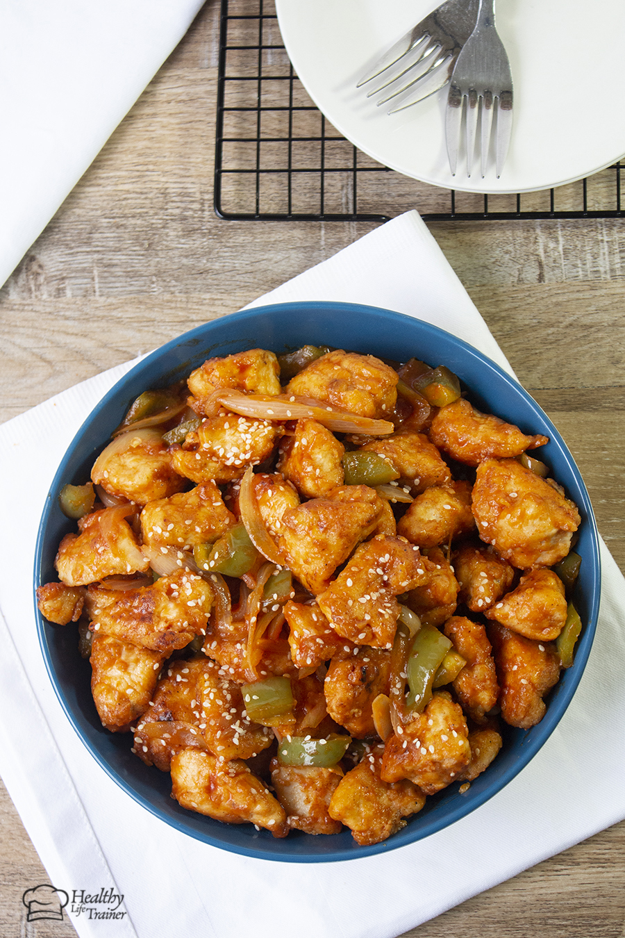 Chinese-style crispy sweet and sour chicken recipe is a crispy light fried chicken simmered in a well-balanced fragranced sticky sauce along with crunchy vegetable chunks.