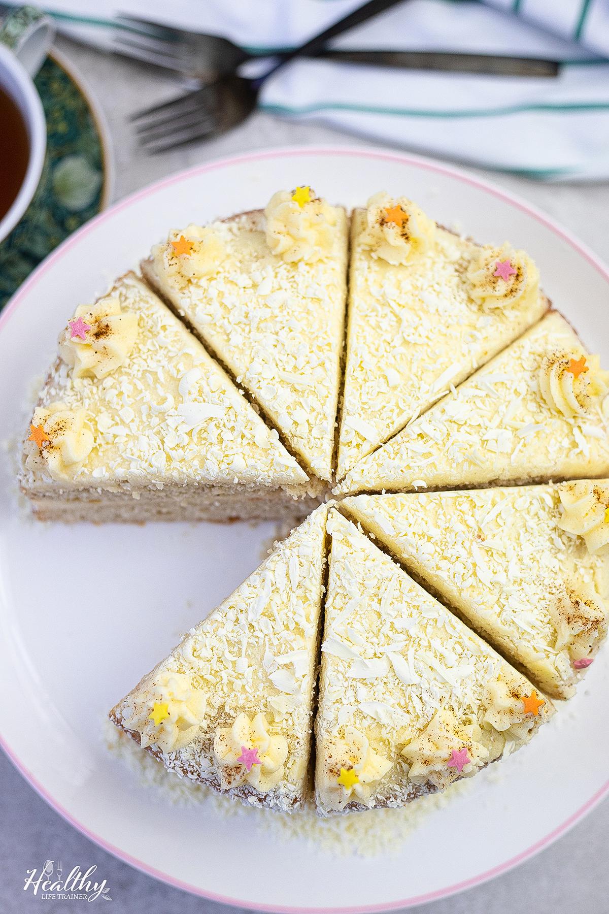 Eggnog Cake with Eggnog Buttercream in a serving dish #eggnogcake #easycake #christmascake #birthdaycake
