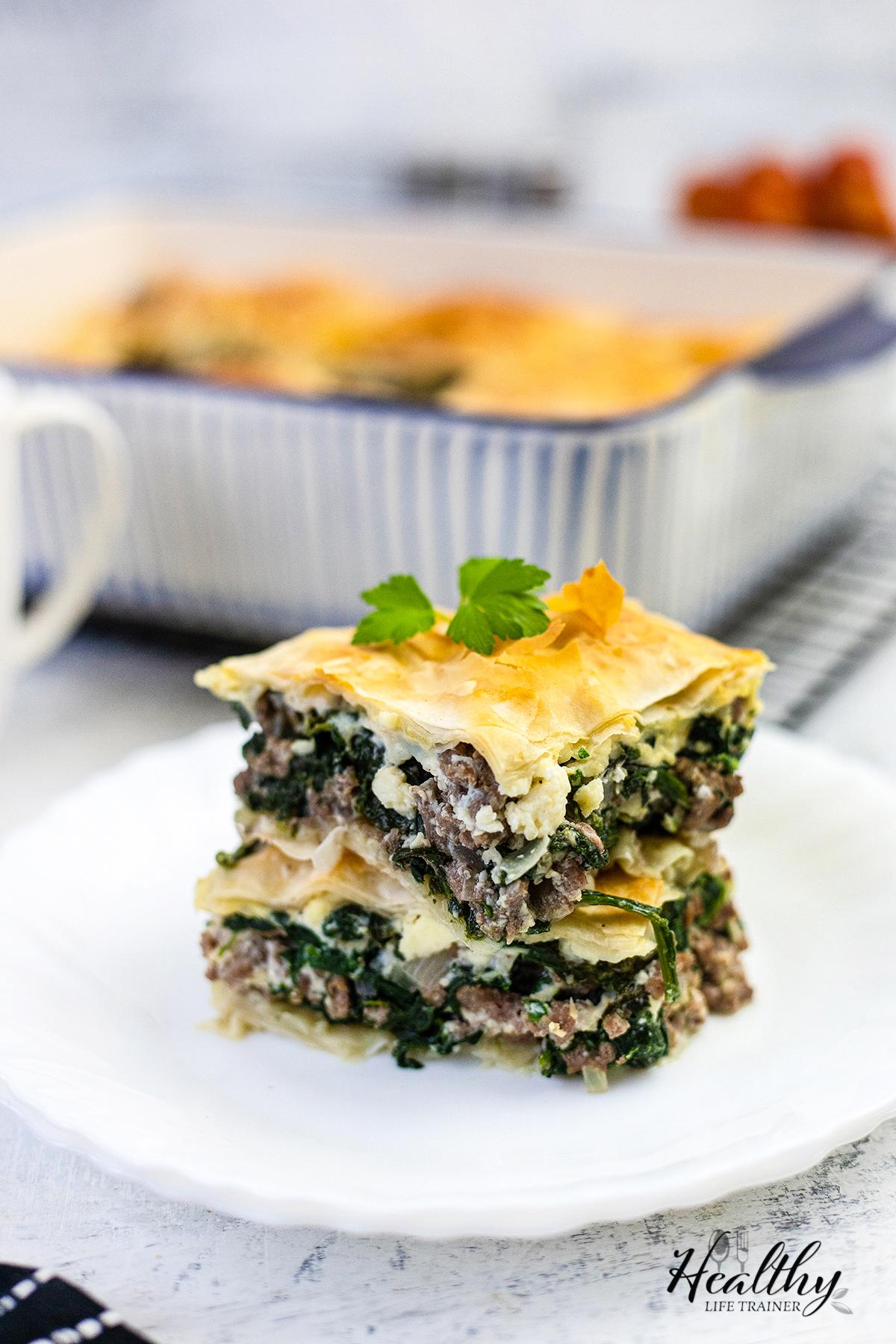 close shot to two pieces of the spinach pie #spanakopitarecipe #spanakopitapie #spinachpie #dinnerpie #mediterraneanrecipe
