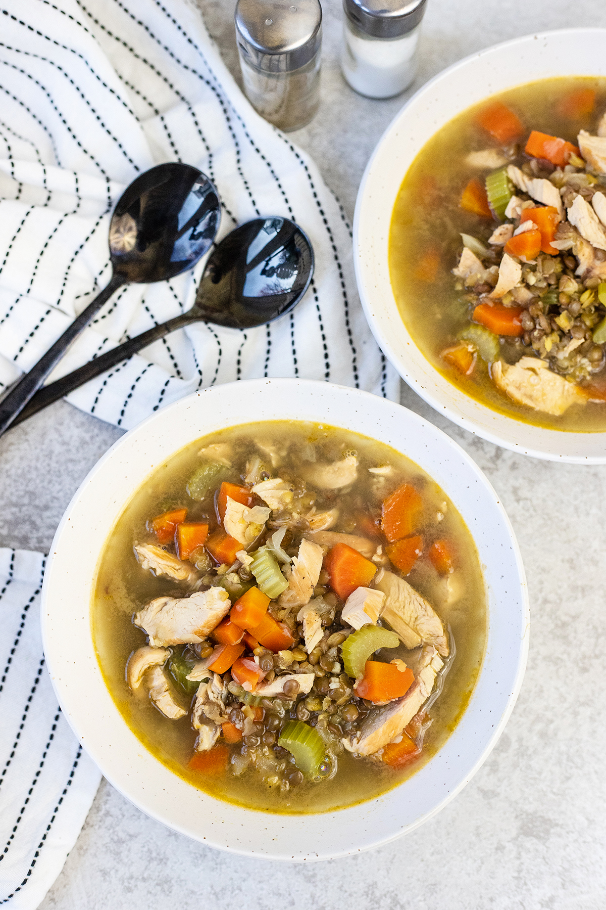 Chicken lentil soup is loaded with chicken, lentils, carrots, and celery.