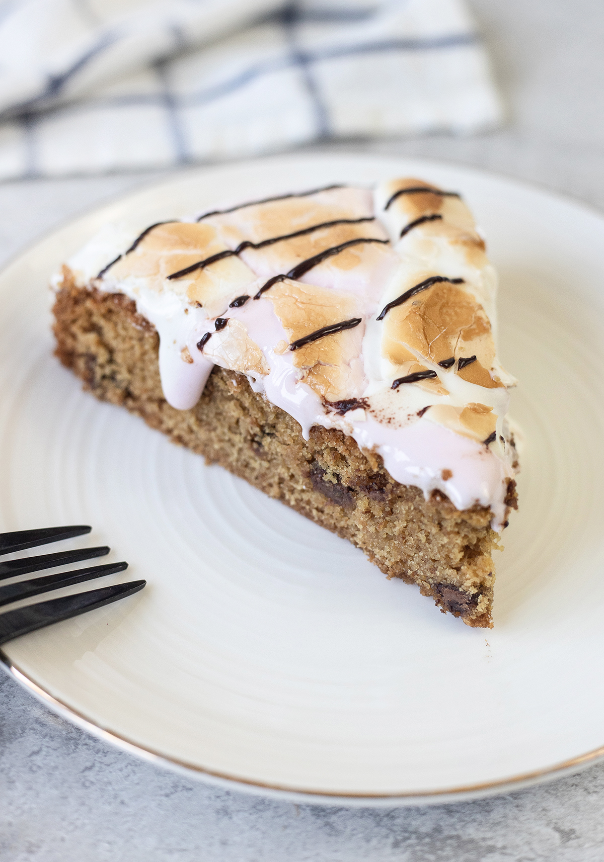 S'mores cookie pie is made with biscuit crumbs and chocolate chips and marshmallows